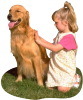 Little girl grooming dog